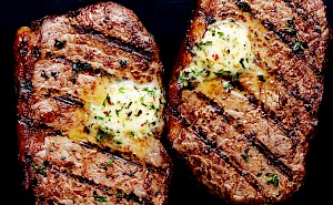 Photograph of Valentine's Day steaks chargrilled with herb butter