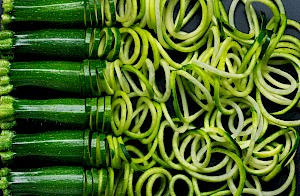Photograph of Courgettes being spiralized into courgetti