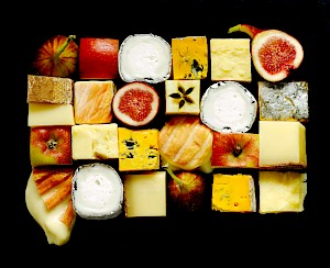 Photograph of cubes of cheeses, apples and figs