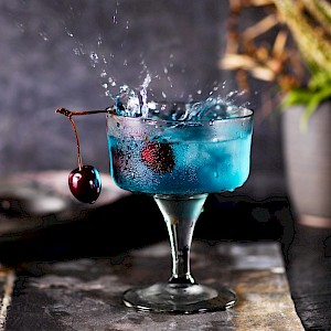 Photograph of a Black Cherry Cocktail with a big splash