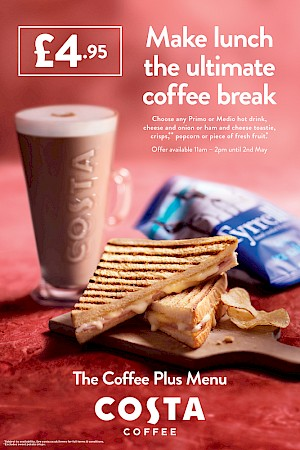 Photograph of toasted sandwich, latte and Tyrrell crisps