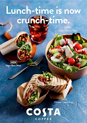 Photograph of  two wraps, salad and iced coffee