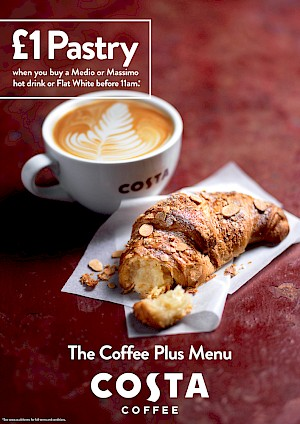 Photograph of a flat white with an almond croissant